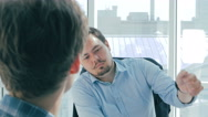 Director discuss project with employee in new modern office Stock Footage