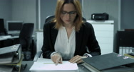 4K: A young employee is filing some documents in a modern office. Stock Footage