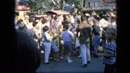 1963: crowd is seen posing beside car. CALIFORNIA Stock Footage