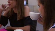 Three young women are talking and drinking coffe at the cafe restaurant. Stock Footage