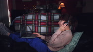 4k Authentic Shot of a Woman Listening to Music on Couch Stock Footage