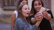 Three female friends are taking a selfie-smartphone. City background Stock Footage
