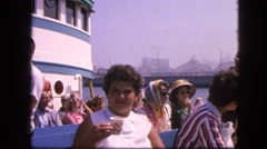 1963: chubby cute short haired girl drinking water on ferry cruise boat Stock Footage