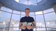 Man throws money. US Dollars Stock Footage