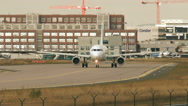 Taxiing airplanes on apron and runways at Frankfurt airport Stock Footage