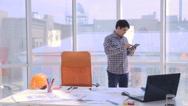 Young architect working with blueprints in the office Stock Footage