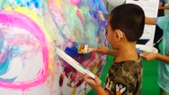 Chinese children are painting the earth model with the brush Stock Footage