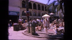 1963: busy tropical vacation spot with people sunbathing CALIFORNIA Stock Footage