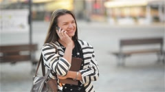 Young happy excited laughing woman talking on mobile phone and girl waves her Stock Footage