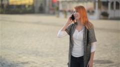 Young happy excited laughing woman talking on mobile phone, girl with red hair Stock Footage