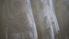 Bride wedding dress hanging on the door - Close up Stock Footage