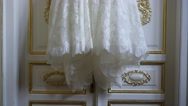 Bride wedding dress hanging on the door - Close up Stock Footage
