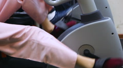 Cycling on a stationary bike Stock Footage