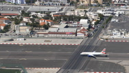 The UK border with Spain at Gibraltar with BA plane Stock Footage