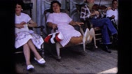 1963: family rocking chair front porch country rural music making CALIFORNIA Stock Footage