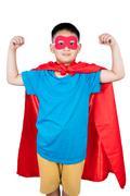 Asian Chinese boy wearing super hero costume showing muscle Kuvituskuvat