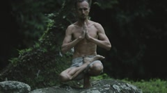 Young man practicing yoga fitness exercises outdoors. Stock Footage