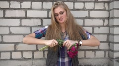 Angry upset Girl throws a Bouquet of Flowers on the Ground Stock Footage