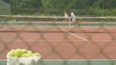 4K Male tennis player practicing his serve on outdoor court in the summer Stock Footage