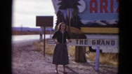 1952: young lady stands in front of