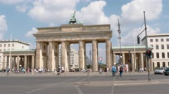 Real time establishing shot of Brandenburg Gate and TV Tower in Berlin Stock Footage