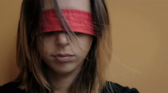 Abused woman with eyes blindfolded with red ribbon Stock Footage