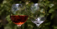 Pink Wine being poured into Glass, Slow motion 4K Stock Footage