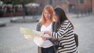 Two young girls on the streets of the old city. Girlfriends try to find their Stock Footage