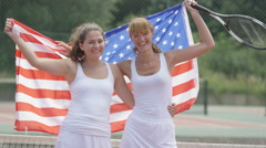 4K Portrait smiling female tennis players with USA flag on outdoor court Arkistovideo