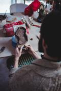 Rear view of craftsman holding clay sculpture in workshop Stock Photos