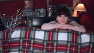 4k Authentic Shot of a Woman Playing Peekaboo on Couch Stock Footage