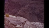 1952: people standing on the edge of large canyon, perhaps the grand canyon Stock Footage