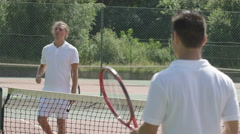 4K Male tennis player takes a break from game to get his breath back Stock Footage