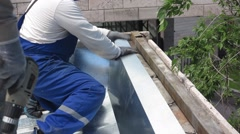 Roofers repair a metal roof Stock Footage