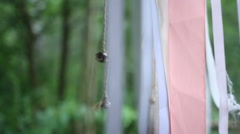 Bell hanging on a ribbon in the wind Stock Footage