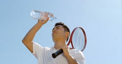 4K Super slow motion, male tennis player pouring water on his head to cool down. Stock Footage