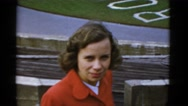 1952: fan looks on at the rose bowl after the football contest has concluded. Stock Footage