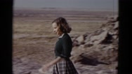 1952: young girl going down rocky trail visiting the site in the sun CALIFORNIA Stock Footage