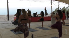 Yogis practice yoga during Yoga Arava weekend of yoga experience in the Arava Stock Footage