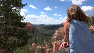 Young woman looking over Bryce Canyon Stock Footage