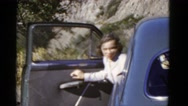 1952: women exits car driving pacific coast highway road. CALIFORNIA Stock Footage