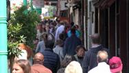 Crowd of people walking on sidewalk Stock Footage
