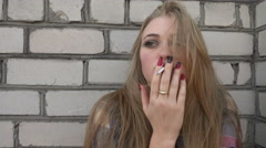 Sad depressed Prostitute Girl smokes a Cigarette against the Wall Arkistovideo