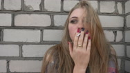 Sad depressed Prostitute Girl smokes a Cigarette against the Wall Stock Footage