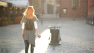 Female throwing empty coffee cup on the trash at the street in the city, On a Stock Footage