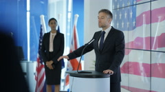 4K Politician making a speech at press conference, american flag in background Stock Footage