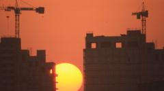 Sunset sun between buildings Stock Footage