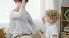Mother Teaching Toddler to High-Five Stock Footage
