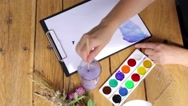 Close up section of female painter artist - hand leading brush. Woman painting a Stock Footage
