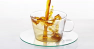 Coffee Being Poured in a Cup against White Background, Slow motion Stock Footage